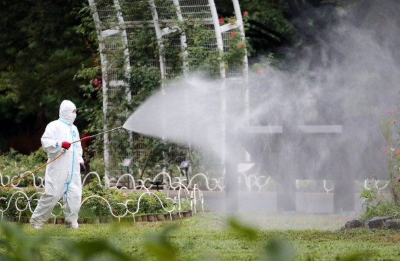 Local authorities This picture taken on August 28, 2014 shows a worker spraying insecticide at the Yoyogi park, one of the largest open spaces in central Tokyo, believed to be the source of the mosquito-borne dengue fever. An outbreak of dengue fever in Japan -- the first since World War II -- could have affected up to 20 people, media reported on September 1, as officials confirmed three more cases.      (Photo Source: AFP via ABC News)
